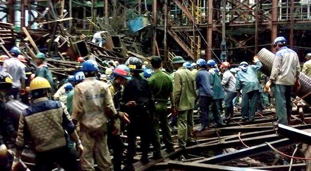 Rescuers look for survivors after scaffolding collapsed in an economic zone in Ha Tinh province in central Vietnam (AP/Vietnam News Agency)