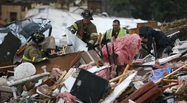 First responders work at a pile of rubble after a round of severe weather hit Oklahoma in the US (AP/Tulsa World)