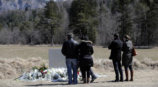Family members of a victim pay tribute in the area where the Germanwings jetliner crashed. (AP)