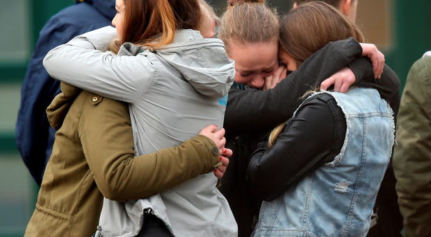 Pupils console one another in Haltern, Germany