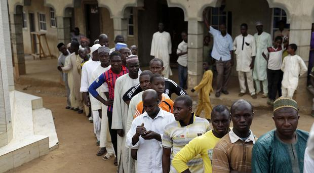 Nigerians queue to cast their vote in the presidential election