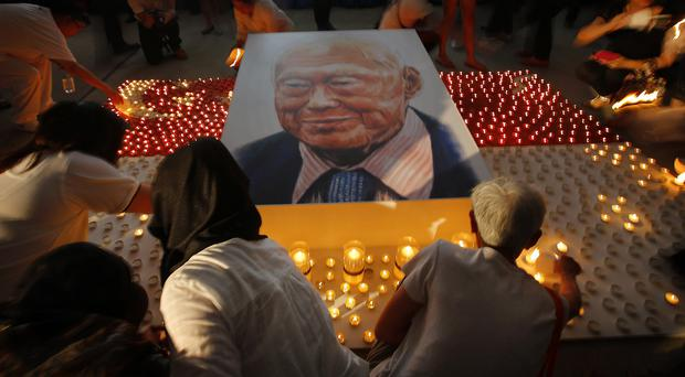 Candles surround a portrait of the late Lee Kuan Yew, regarded as Singapore's founding father (AP)