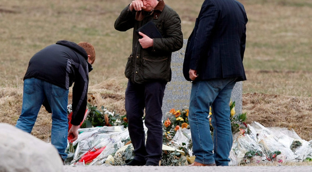 Philip Bramley, whose son Paul was killed, wipes away tears at the Alps memorial yesterday