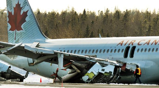 The Air Canada plane landed short of the runway during a snowstorm at Stanfield International Airport in Halifax, Nova Scotia (The Canadian Press/AP)