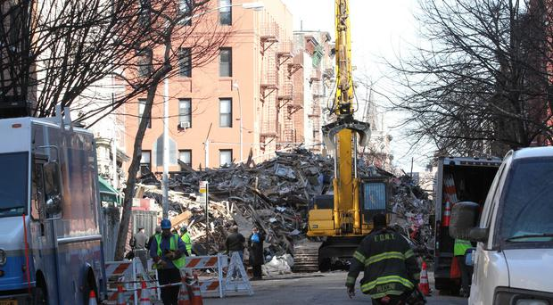 The site of the apparent gas explosion in the East Village neighbourhood of New York (AP)