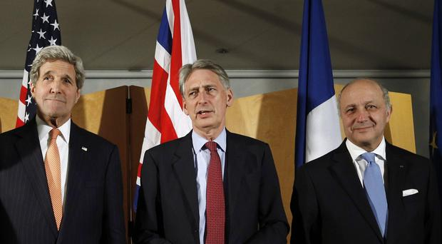 US secretary of state John Kerry, UK Foreign Secretary Philip Hammond and French foreign minister Laurent Fabius after talks over Iran's nuclear programme (AP)