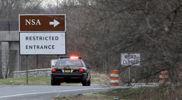 A police car sits at a blocked entrance on a road to the National Security Agency (AP)