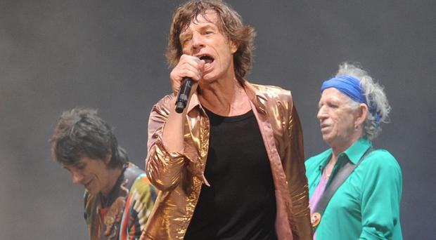 Mick Jagger, centre, Keith Richards, right, and Ronnie Wood are bringing a new Rolling Stones tour to stadiums across North America
