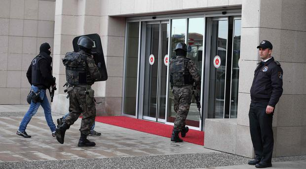 Members of special security forces enter the main courthouse in Istanbul, Turkey, as a chief prosecutor is being held hostage (AP)