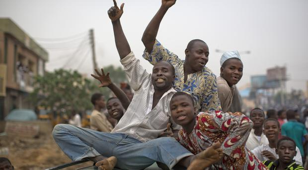Supporters of Muhammadu Buhari in Kano celebrate his victory (AP)
