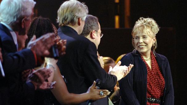 Joni Mitchell, pictured at a gala for the Queen in Canada, has been taken to hospital
