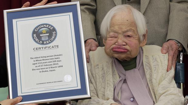 Misao Okawa, pictured in 2013 when she was 114, with her certificate for being the world's oldest woman (AP)