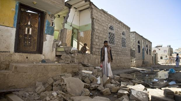 A Yemeni man stands near his house destroyed by Saudi airstrikes near Sanaa Airport, Yemen (AP)