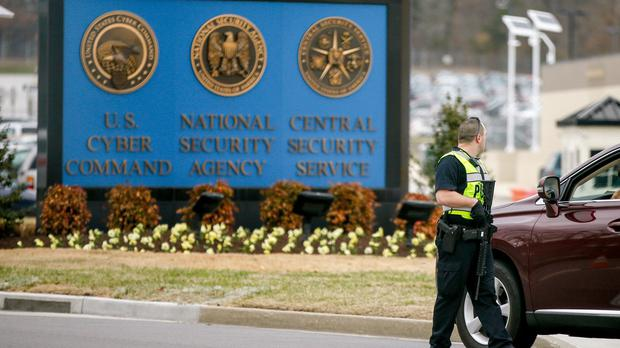A police officer stands at a gate to Fort Meade directing a vehicle to turn away after a vehicle rammed a gate to the National Security Agency (AP)