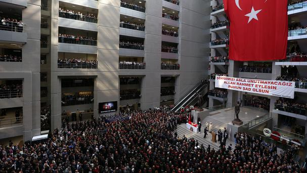 Some thousands of people attend the funeral ceremony for Turkish prosecutor Mehmet Selim Kiraz in Istanbul (AP)