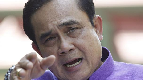 Thailand's Prime Minister Prayuth Chan-ocha answers questions from reporters during a press conference at the government house in Bangkok (AP)