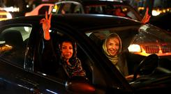 Iranians in Tehran celebrating Iran's nuclear agreement with world powers (AP)