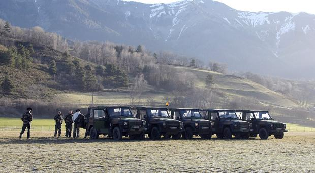 Mountain troops park their vehicle before heading to the crash site in Seyne-les-Alpes, France (AP)