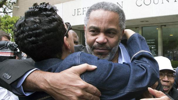 Ray Hinton hugs a supporter as he leaves the Jefferson County jail (AP)