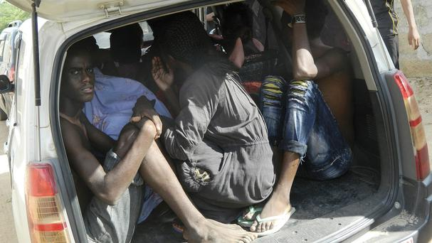 Students sheltering in a vehicle after fleeing the attack