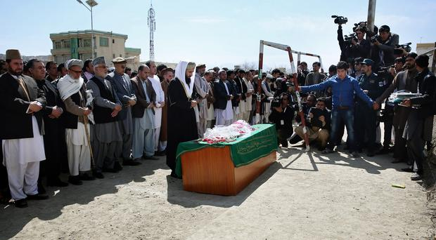 Civil society activists and relatives pray during the funeral of 27-year-old Farkhunda on March 22 (AP)