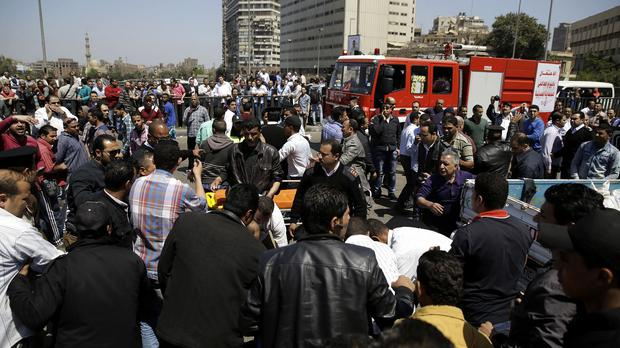 People gather at the scene of an explosion that killed at least one person on a bridge over the Nile River in Cairo (AP)