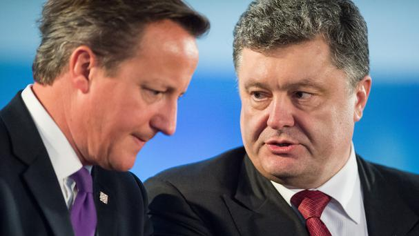 Ukrainian president Petro Poroshenko, pictured with David Cameron, has met a parliamentary commission that is drafting amendments to Ukraine's main law
