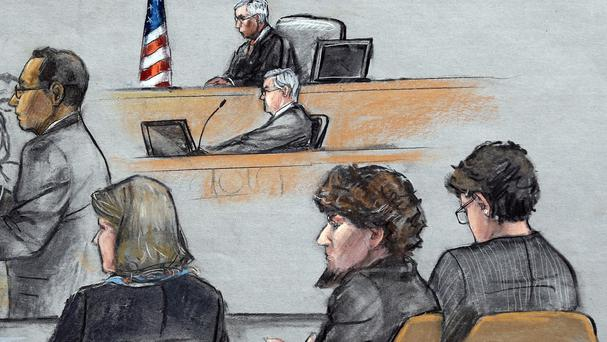 In this courtroom sketch, assistant US attorney Aloke Chakravarty, far left, addresses the jury as Dzhokhar Tsarnaev, second from right, sits between his defence lawyers (AP)