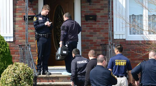 Police search the home where an 100-year-old man apparently murdered his wife as she slept, then killed himself (Northjersey.com/AP)