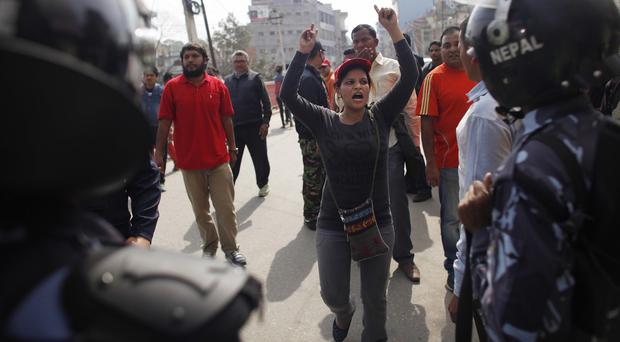 A Nepalese demonstrator shouts during a general strike demanding a new constitution draft be passed by a national consensus, in Kathmandu (AP)