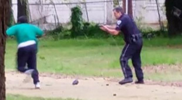 The video shows Mr Scott appearing to run away from City Patrolman Michael Slager, before the officer apparently shoots him several times in the back (Courtesy of Chris Stewart/AP)
