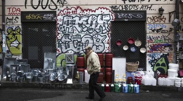 Greece's government has been locked in strained negotiations with creditors since winning elections on pledges to abolish austerity measures required by the rescue programme (AP)
