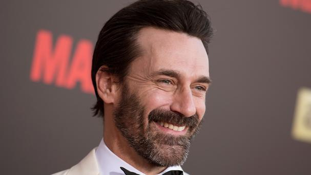 Jon Hamm was accused of helping to lead a violent 1990 'hazing' at the University of Texas (Invision/AP)