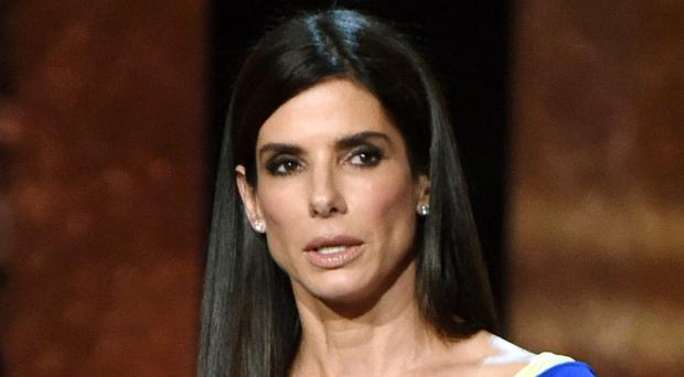Sandra Bullock hid in a cupboard as a man clutching a love letter to the star broke into her home (Invision/AP)