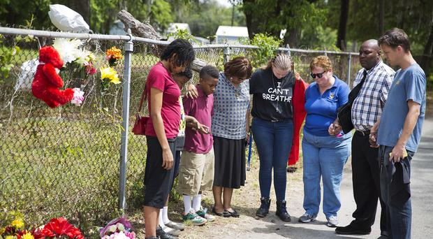 A group prays at the scene where Walter Scott was killed by a North Charleston police officer