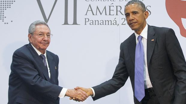 Barack Obama and Raul Castro begin their historic meeting with a handshake at the Summit of the Americas in Panama City (AP)