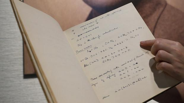 Code-breaker Alan Turing's notebook sold for more than $1m at a New York auction (AP)