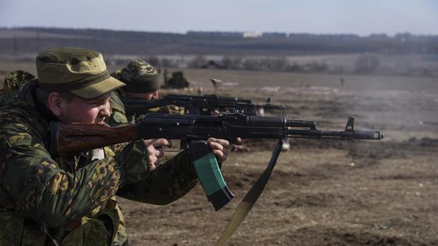 Pro-Russian rebels participate in a military training exercise near Yenakiyeve, in the Donetsk region last month. (AP)