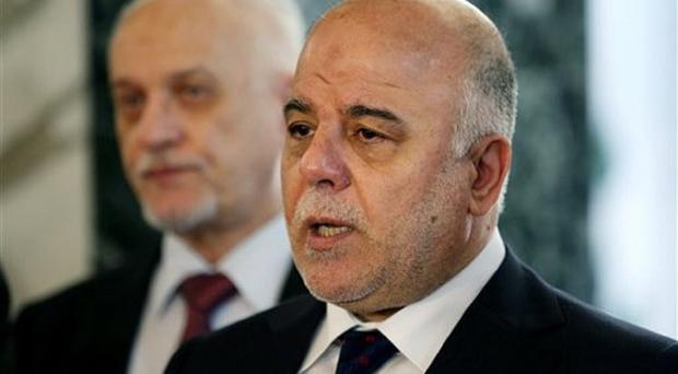 Iraqi prime minister Haider al-Abadi prepares to leave Baghdad Airport to fly to the US. (AP)