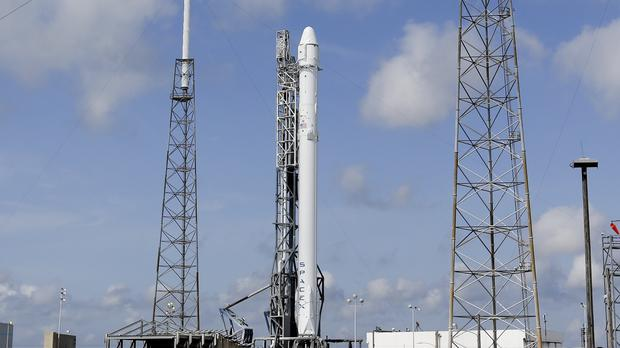 The Falcon 9 SpaceX rocket stands ready for launch at Cape Canaveral (AP/John Raoux)