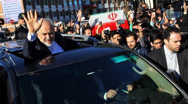 Foreign minister Mohammad Javad Zarif, Iran's top nuclear negotiator, arriving in Tehran from talks in Switzerland (AP)