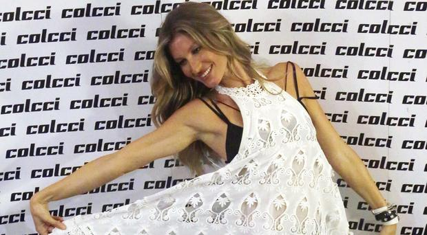 Gisele Bundchen poses for photos during Sao Paulo Fashion Week (AP)