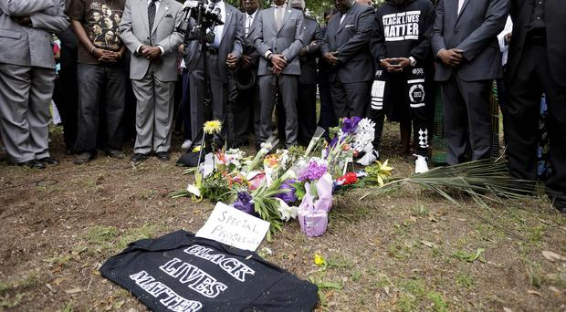 Mourners visit a makeshift memorial where Walter Scott was fatally shot by a white police officer. (AP)