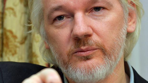 Julian Assange says the hacked documents belong in the public domain
