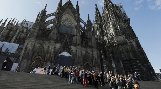People queue in front of Cologne Cathedral for a ceremony in memory of the victims of the Germanwings plane crash (AP)