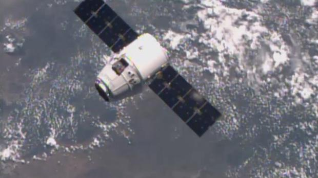 The SpaceX Dragon-6 resupply capsule near the International Space Station (NASA-TV via AP)