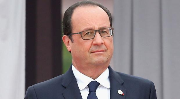Francois Hollande said France is negotiating with Russia over the weapons deal