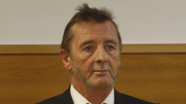 Phil Rudd stands in the dock at the Tauranga court where he pleaded guilty to threatening to kill a man who used to work for him and possessing drugs