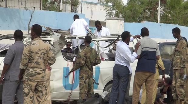 The scene following a bomb attack on a van carrying UN employees in Puntland, Somalia. (AP)
