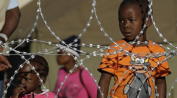 Children at a shelter for displaced foreigners east of Johannesburg. (AP)